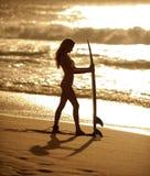 Muchacha 3 de la persona que practica surf imagen de archivo libre de regalías