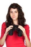 Muchacha adolescente adorable con los prismáticos Imagen de archivo libre de regalías