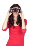 Muchacha adolescente adorable con los prismáticos Fotos de archivo