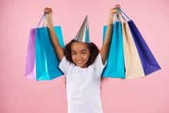 Muchacha adolescente afroamericana en sombrero festivo Foto de archivo libre de regalías