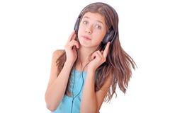 Muchacha adolescente agradable con los auriculares Imágenes de archivo libres de regalías