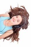 Muchacha adolescente agradable con los auriculares Fotografía de archivo
