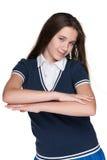 Muchacha adolescente alegre contra el blanco Imagen de archivo