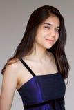 Muchacha adolescente biracial hermosa en vestido púrpura Fotos de archivo libres de regalías