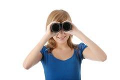 Muchacha adolescente con binocular Imágenes de archivo libres de regalías