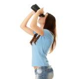 Muchacha adolescente con binocular Fotos de archivo libres de regalías