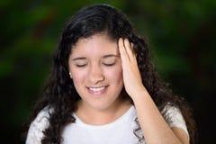 Muchacha adolescente con dolor de cabeza Foto de archivo libre de regalías