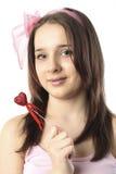 Muchacha adolescente con el corazón Fotos de archivo