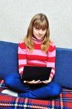 Muchacha adolescente con el cuaderno Foto de archivo