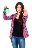 Muchacha adolescente con el despertador Fotos de archivo libres de regalías