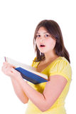 Muchacha adolescente con el libro asombroso Imágenes de archivo libres de regalías