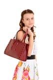 Muchacha adolescente con el monedero Imágenes de archivo libres de regalías