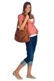 Muchacha adolescente con el monedero Fotografía de archivo libre de regalías