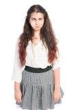 Muchacha adolescente con el pelo largo que hace la cara divertida Foto de archivo libre de regalías