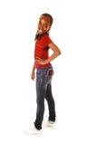 Muchacha adolescente con el teléfono móvil en bolsillo. Imagen de archivo libre de regalías