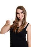Muchacha adolescente con el vidrio de leche Imágenes de archivo libres de regalías
