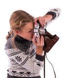 Muchacha adolescente con la cámara retra en un blanco Imagenes de archivo