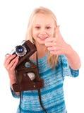 Muchacha adolescente con la cámara retra en un fondo blanco Imagenes de archivo