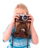 Muchacha adolescente con la cámara retra en un fondo blanco Fotografía de archivo libre de regalías