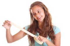 Muchacha adolescente con la cinta adhesiva Imagenes de archivo