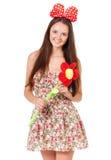 Muchacha adolescente con la flor grande Imagen de archivo