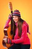 Muchacha adolescente con la guitarra Fotografía de archivo libre de regalías