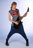 Muchacha adolescente con la guitarra eléctrica Imagen de archivo