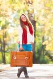 Muchacha adolescente con la maleta Imagen de archivo libre de regalías