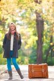 Muchacha adolescente con la maleta Imagen de archivo