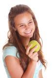 Muchacha adolescente con la manzana Fotografía de archivo libre de regalías