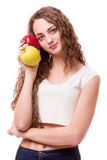 Muchacha adolescente con la manzana en manos Imagenes de archivo