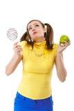 Muchacha-adolescente con la manzana y el caramelo Imágenes de archivo libres de regalías