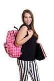 Muchacha adolescente con la mochila y los libros de escuela Imagenes de archivo