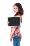 Muchacha adolescente con la pequeña pizarra Fotos de archivo