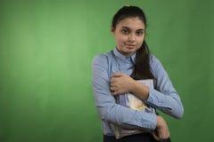 Muchacha adolescente con la pila de libros Fotografía de archivo