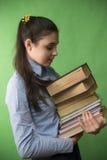 Muchacha adolescente con la pila de libros Imágenes de archivo libres de regalías