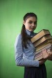 Muchacha adolescente con la pila de libros Fotografía de archivo libre de regalías