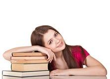 Muchacha adolescente con la porción de libros Fotografía de archivo