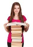 Muchacha adolescente con la porción de libros Foto de archivo libre de regalías