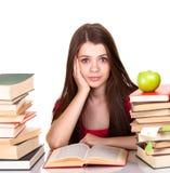 Muchacha adolescente con la porción de libros Fotografía de archivo libre de regalías
