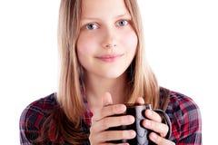 Muchacha adolescente con la taza Imágenes de archivo libres de regalías