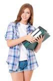 Muchacha adolescente con las carpetas Fotografía de archivo