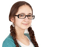 Muchacha adolescente con las coletas que desgastan los vidrios Imágenes de archivo libres de regalías
