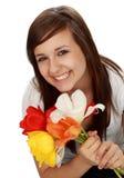 Muchacha adolescente con las flores Imagen de archivo