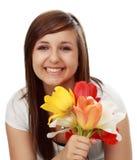 Muchacha adolescente con las flores Imágenes de archivo libres de regalías