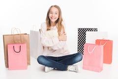 Muchacha adolescente con los bolsos de compras Imagen de archivo libre de regalías