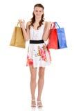 Muchacha adolescente con los bolsos de compras Fotos de archivo