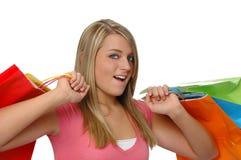 Muchacha adolescente con los bolsos de compras s Foto de archivo