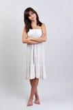 Muchacha adolescente con los brazos cruzados Foto de archivo libre de regalías