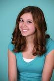 Muchacha adolescente con los enrollamientos Imagenes de archivo